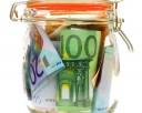 Money jar containing Euro notes isolated on white