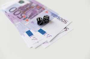 close up of black dice and euro cash money